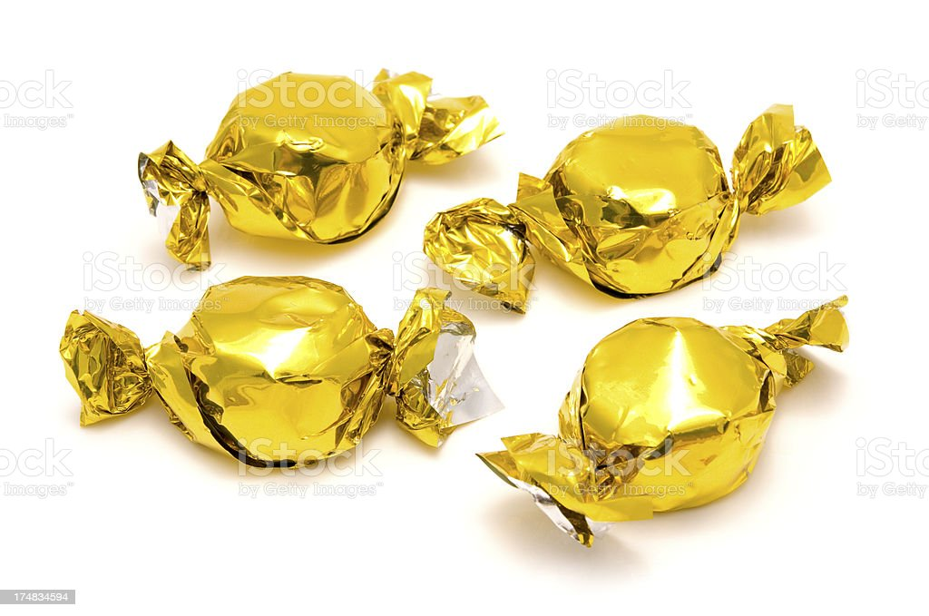 Sweets in gold foil wrappers royalty-free stock photo