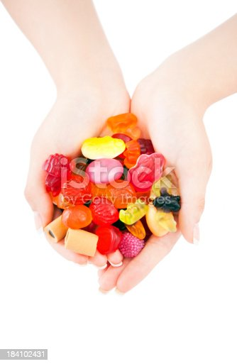 Sweets mix in hands on white