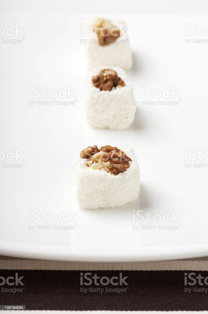 Sweets on a white plate royalty-free stock photo