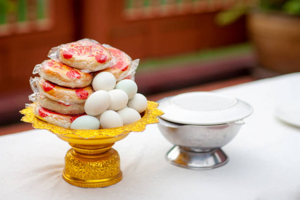 sweets on golden tray in chinese wedding ceremony stock photo