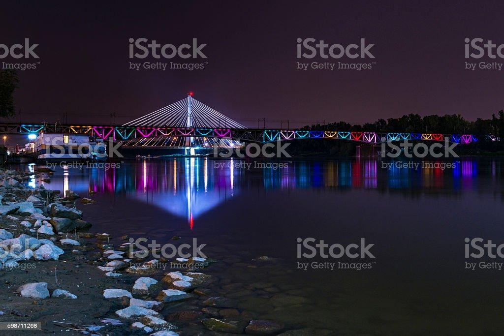 Swietokrzystki bridge at night in Warsaw, Poland stock photo