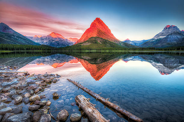 swiftcurrent lake at dawn - us glacier national park stock pictures, royalty-free photos & images