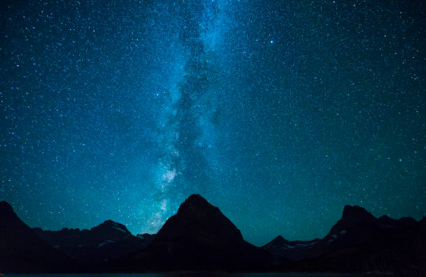 Swiftcurrent Lake  at night with star in Many Glacier area ,Montana's Glacier National Park,Montana,usa. stock photo