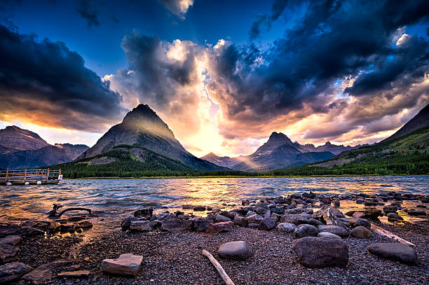 swiftcurrent lake at sunset - us glacier national park stock pictures, royalty-free photos & images