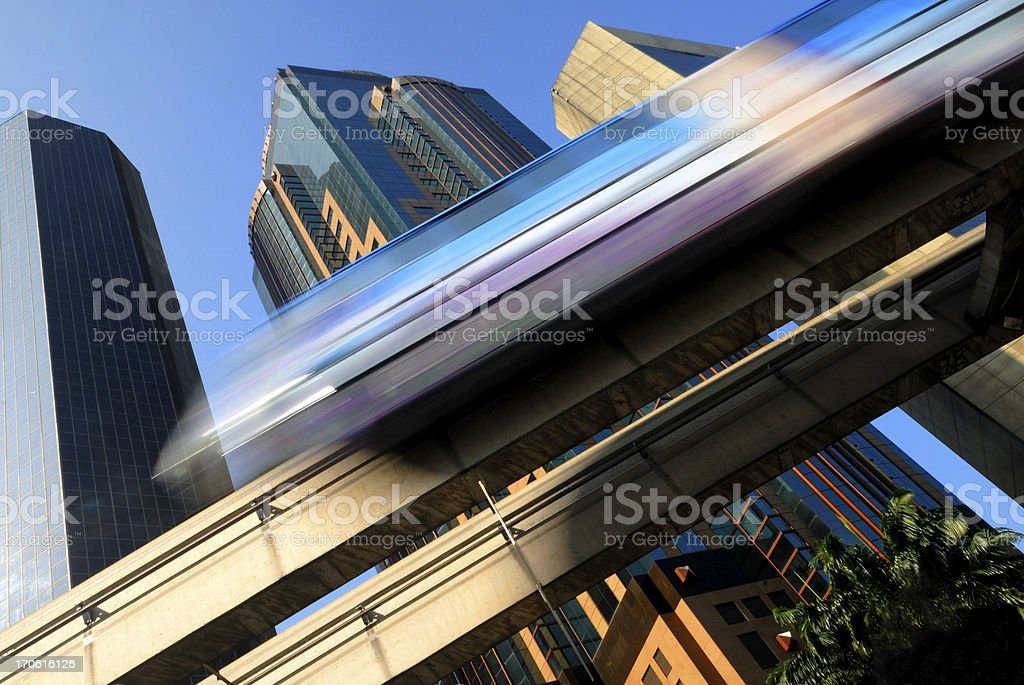 Swiftly-moving monorail against several skyscraper buildings royalty-free stock photo