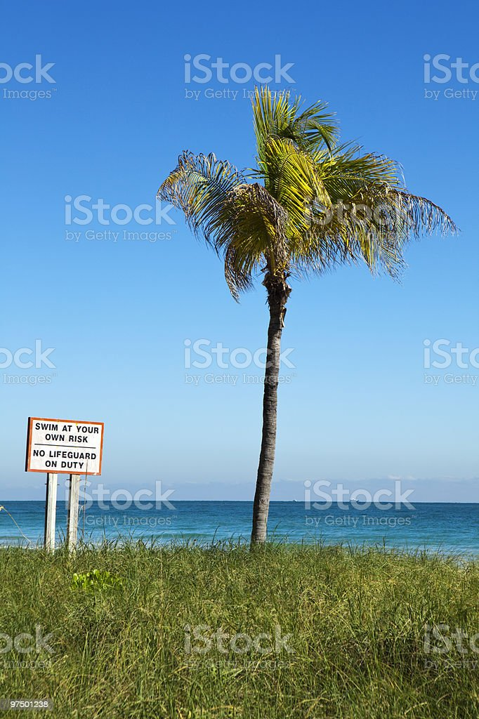 Swim At Your Own Risk, Vertical royalty-free stock photo