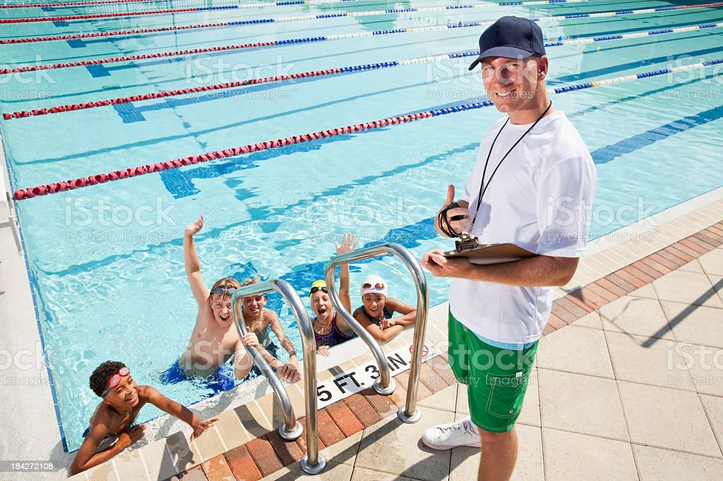 Swim team with coach stock photo