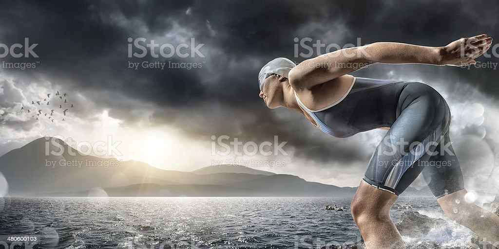 Swimmer About To Dive In Sea stock photo