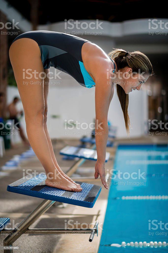 Swimmer about to dive stock photo