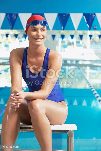istock Swimmer at poolside 520169346