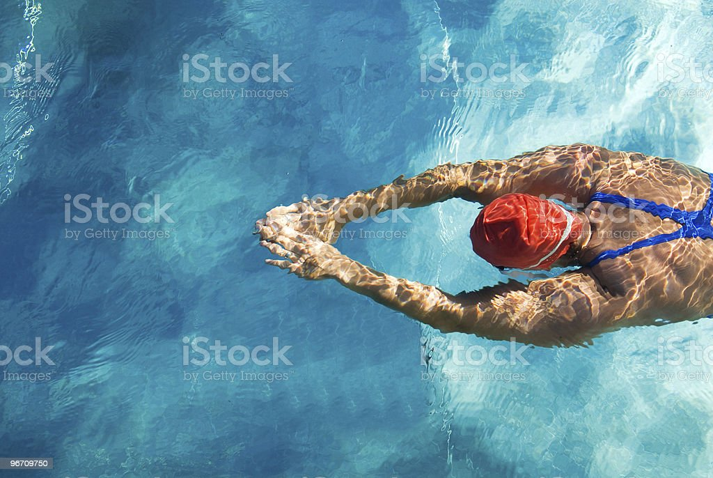 Swimmer diving in swimming pool stock photo