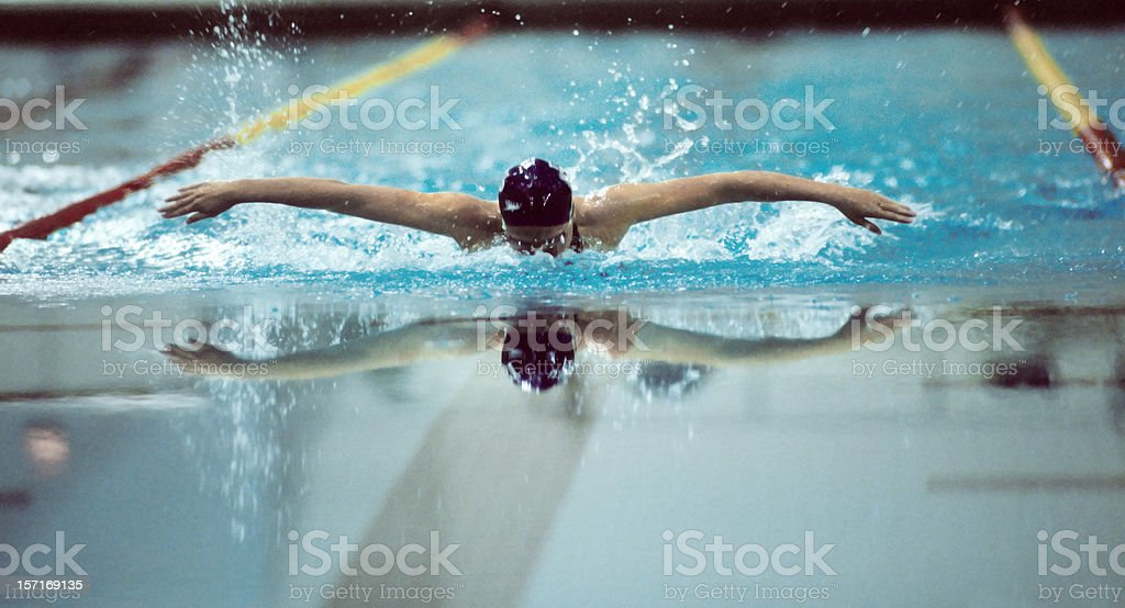 Swimmer, doing the butterfly stock photo