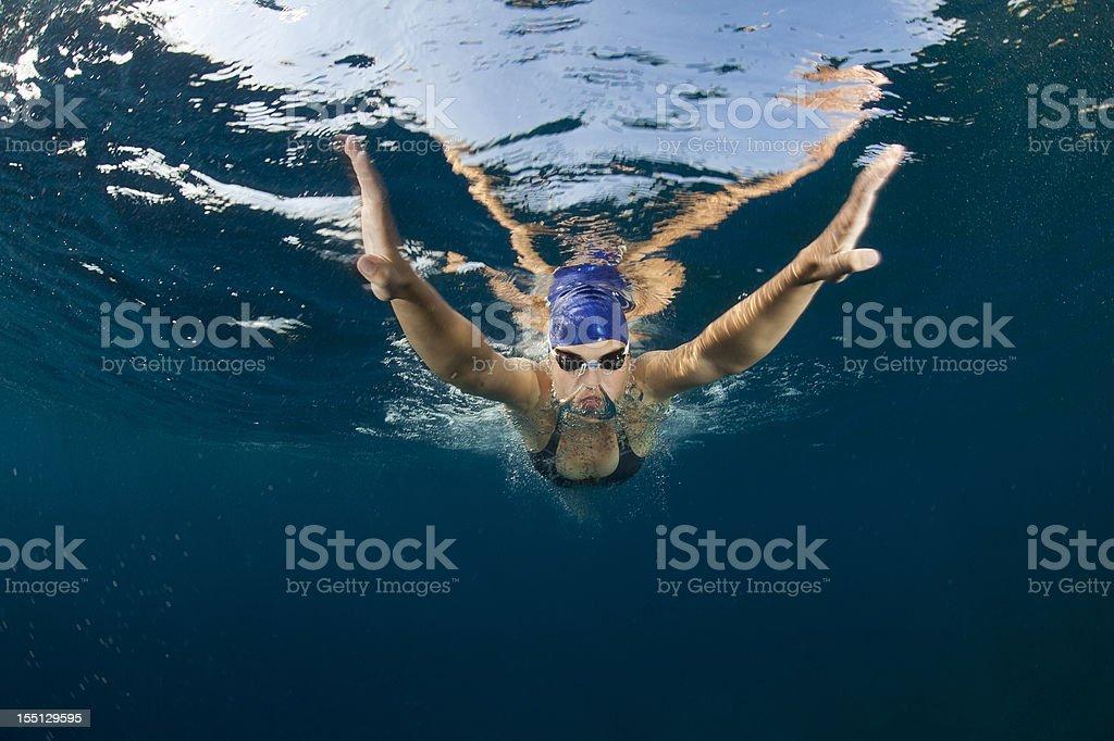 Swimmer exhaling underwater stock photo