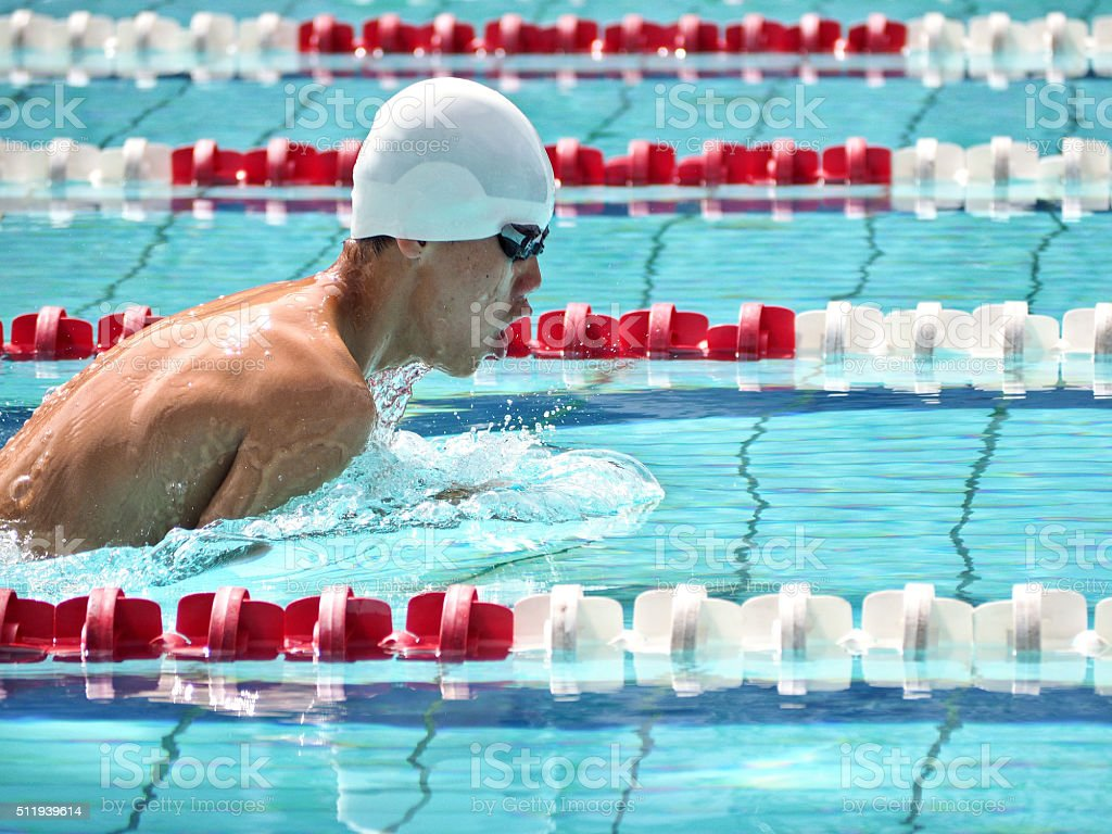 Young teenage Asian swimmer in swimming competition