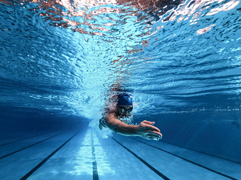 Swimmer swimm freestyle in swimming pool