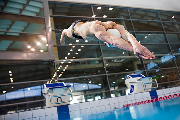 Swimmer jumping stock photo