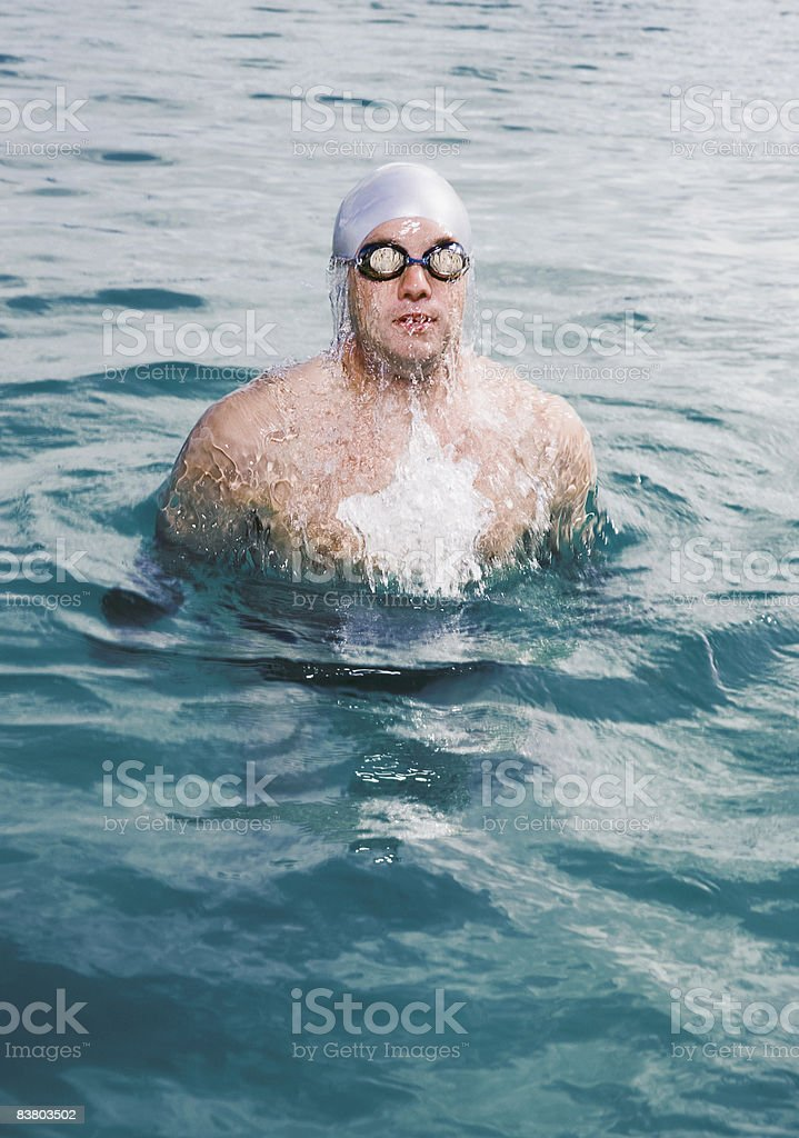 Swimmer launching himself out of the water  royalty-free stock photo