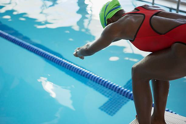 Swimmer on a starting block stock photo