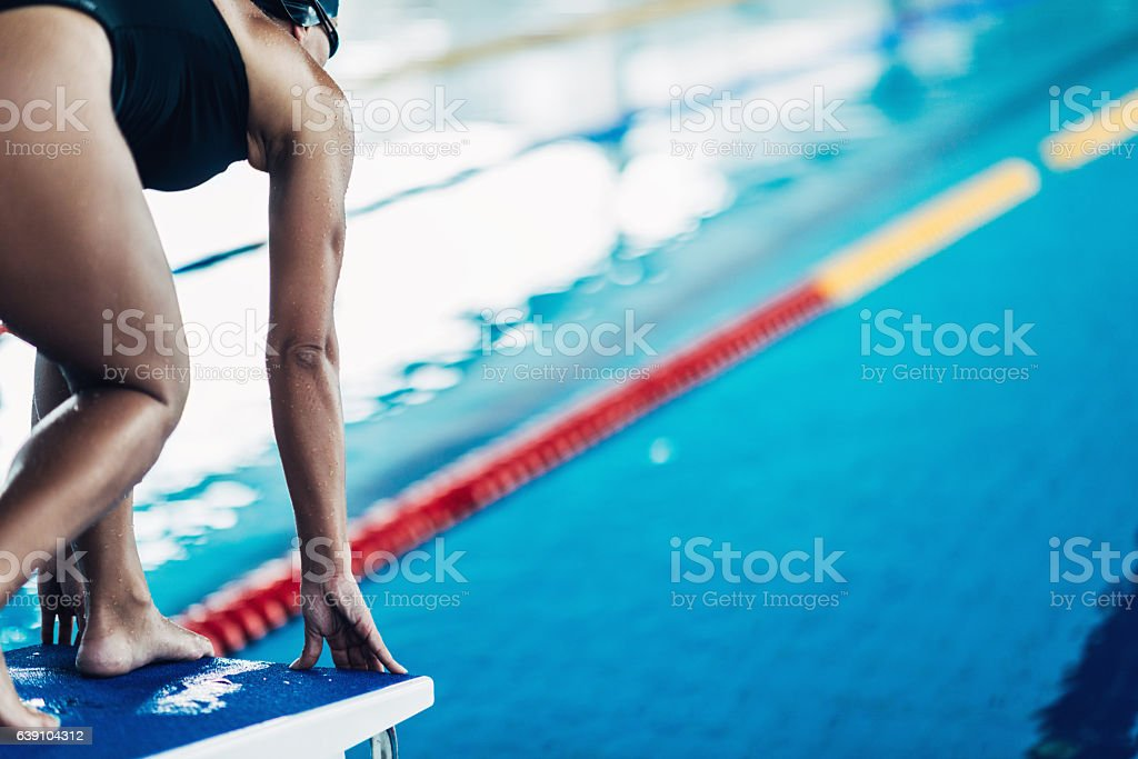Swimmer on starting block stock photo