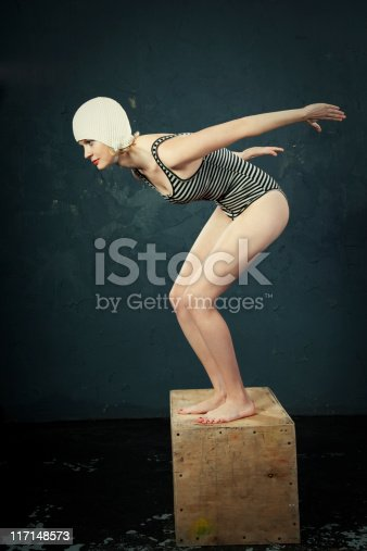 Young retro woman going to dive, toned image