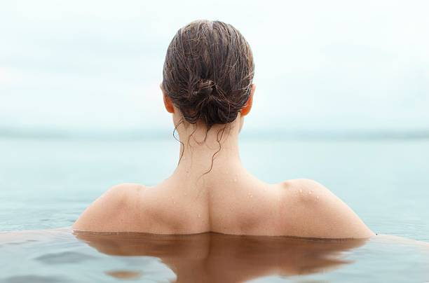 swimmer photo girls bathing in the river wet hair stock pictures, royalty-free photos & images