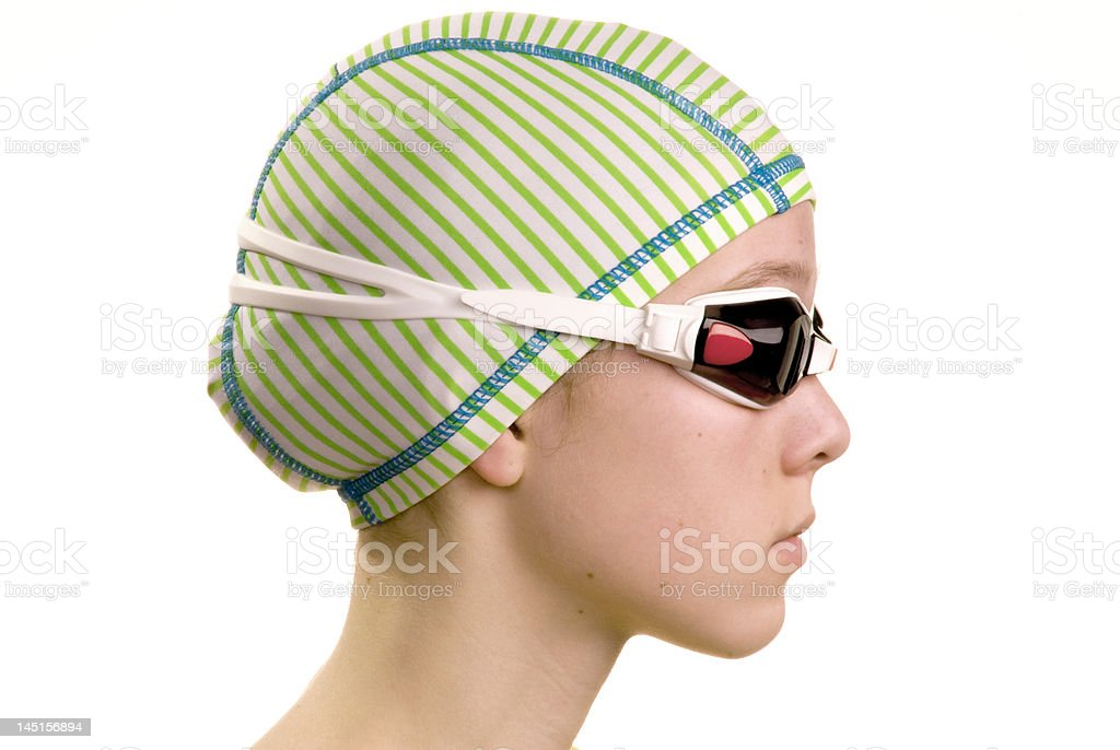 Swimmer profile with cap and goggles royalty-free stock photo