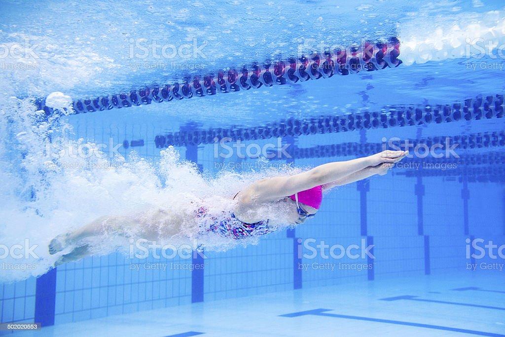 Swimmer speeding through the pool stock photo