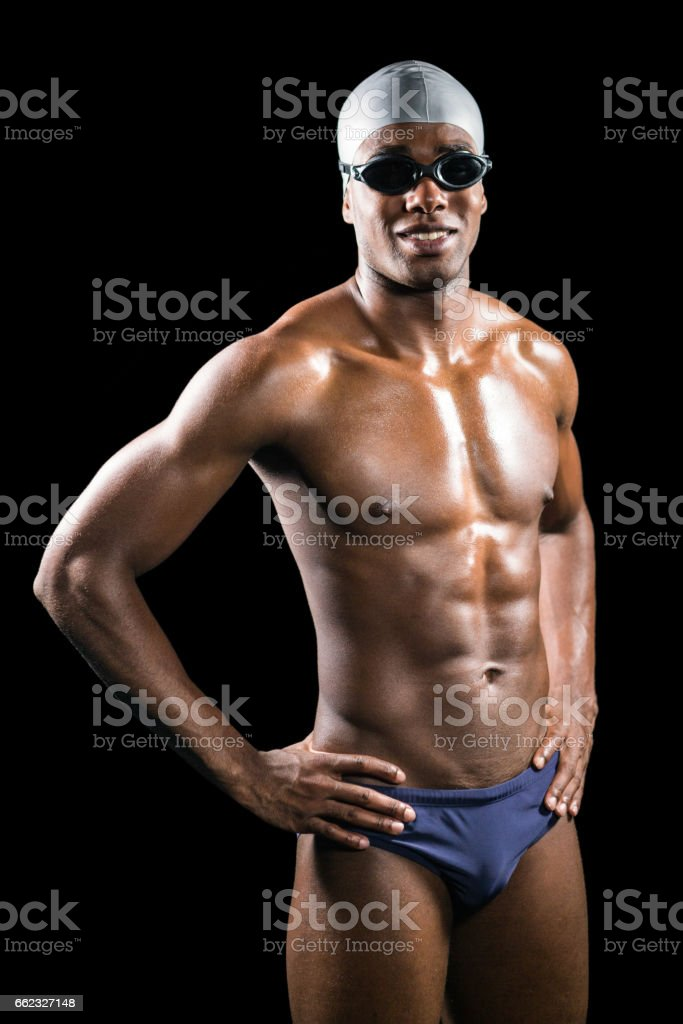 Swimmer standing with hand on hip royalty-free stock photo