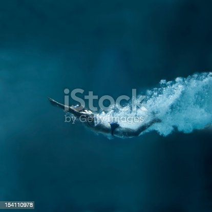 istock Swimmer underwater after the jump on blue background 154110978