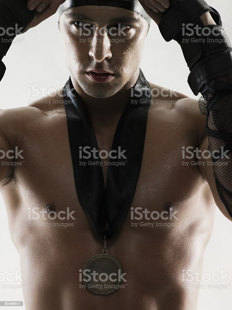 Swimmer wearing a medal royalty-free stock photo
