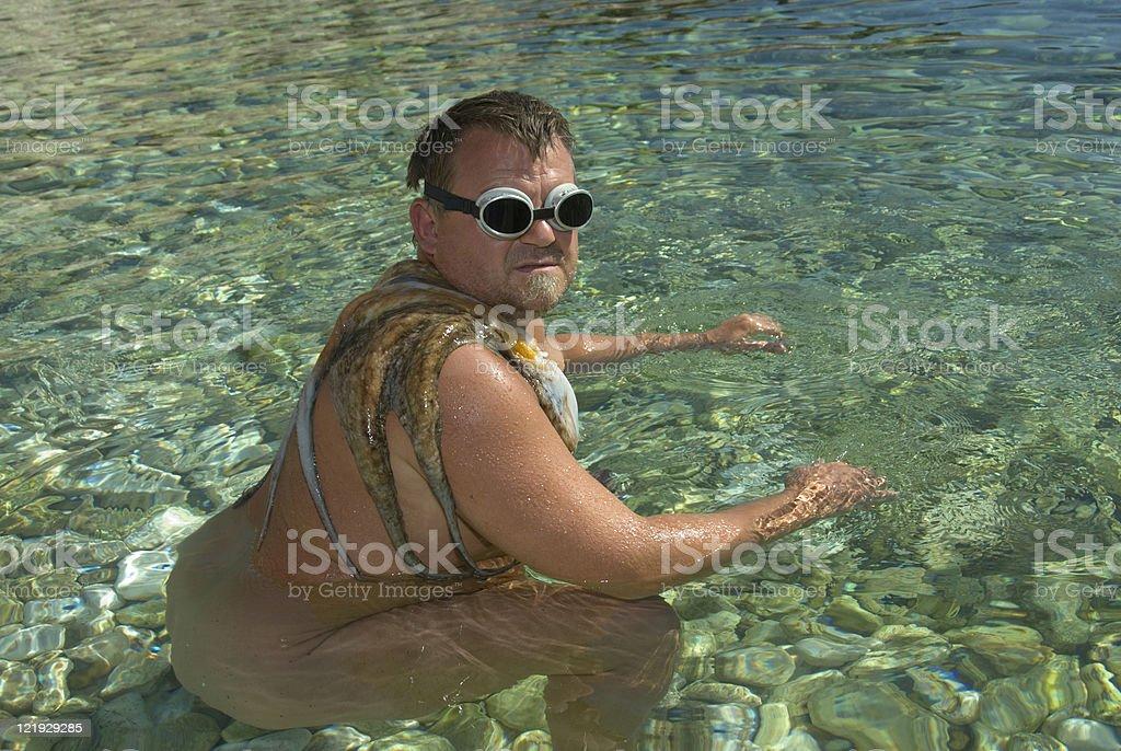 Schwimmer mit Tintenfisch stock photo