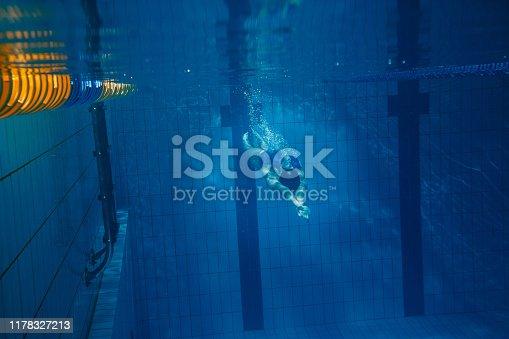 177281231istockphoto Swimmer woman underwater 1178327213