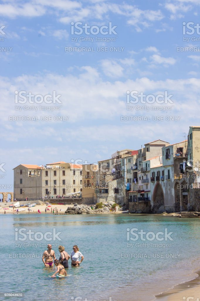 Swimmers in Cefalu Sicily stock photo