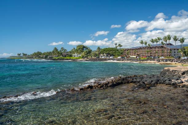 Swimmers in the ocean at Lawai Beach on south coast of Kauai near Poipu stock photo