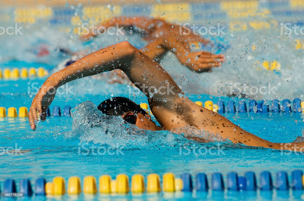 Swimmers Racing stock photo