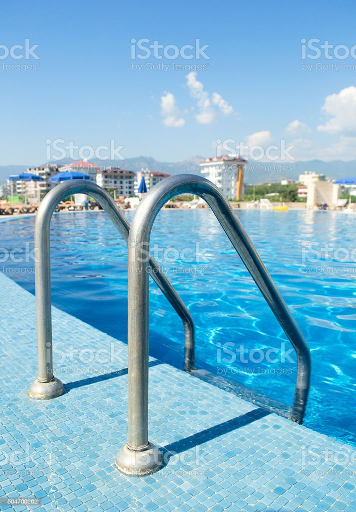 Swimmimg pool with stairs outdoor. Selective focus. stock photo