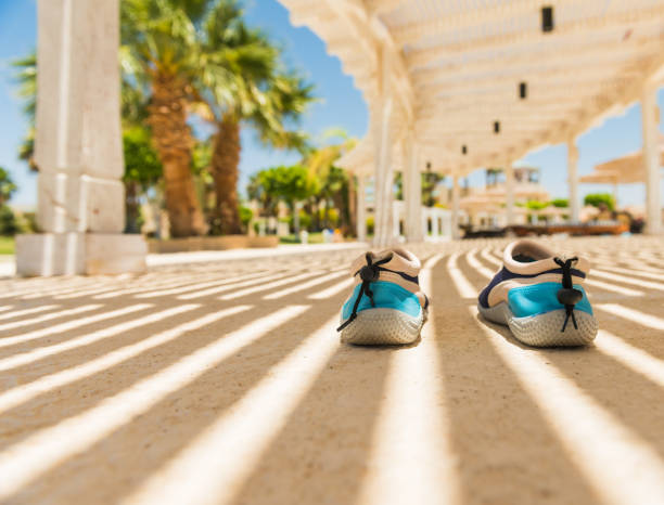 swimmimg shoes under shadows stock photo