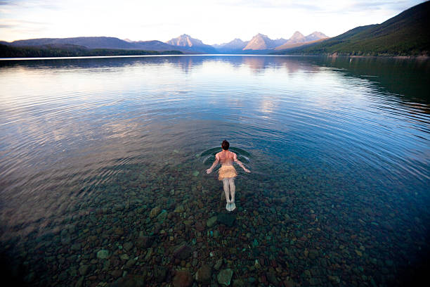 swimming alone in a pristine mountain lake, montana - mcdonald lake stock pictures, royalty-free photos & images