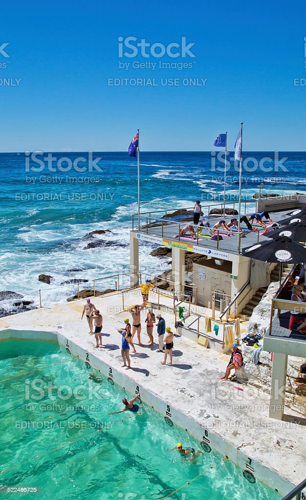 Swimming and yoga at Bondi Icebergs Club stock photo