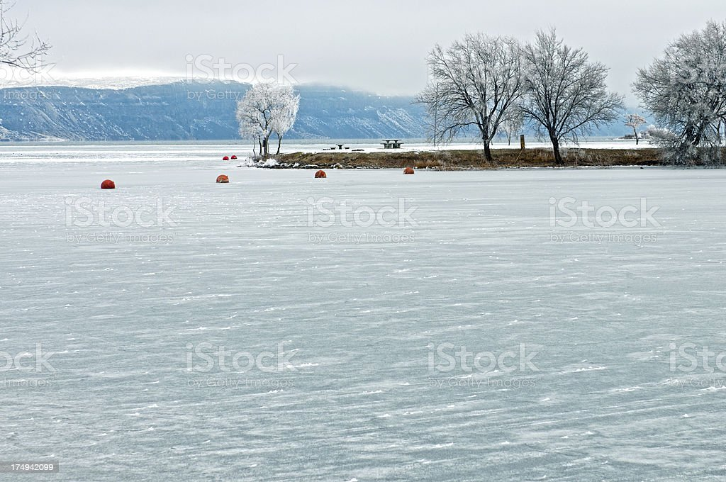 Swimming area marked by buoys in frozen lake royalty-free stock photo