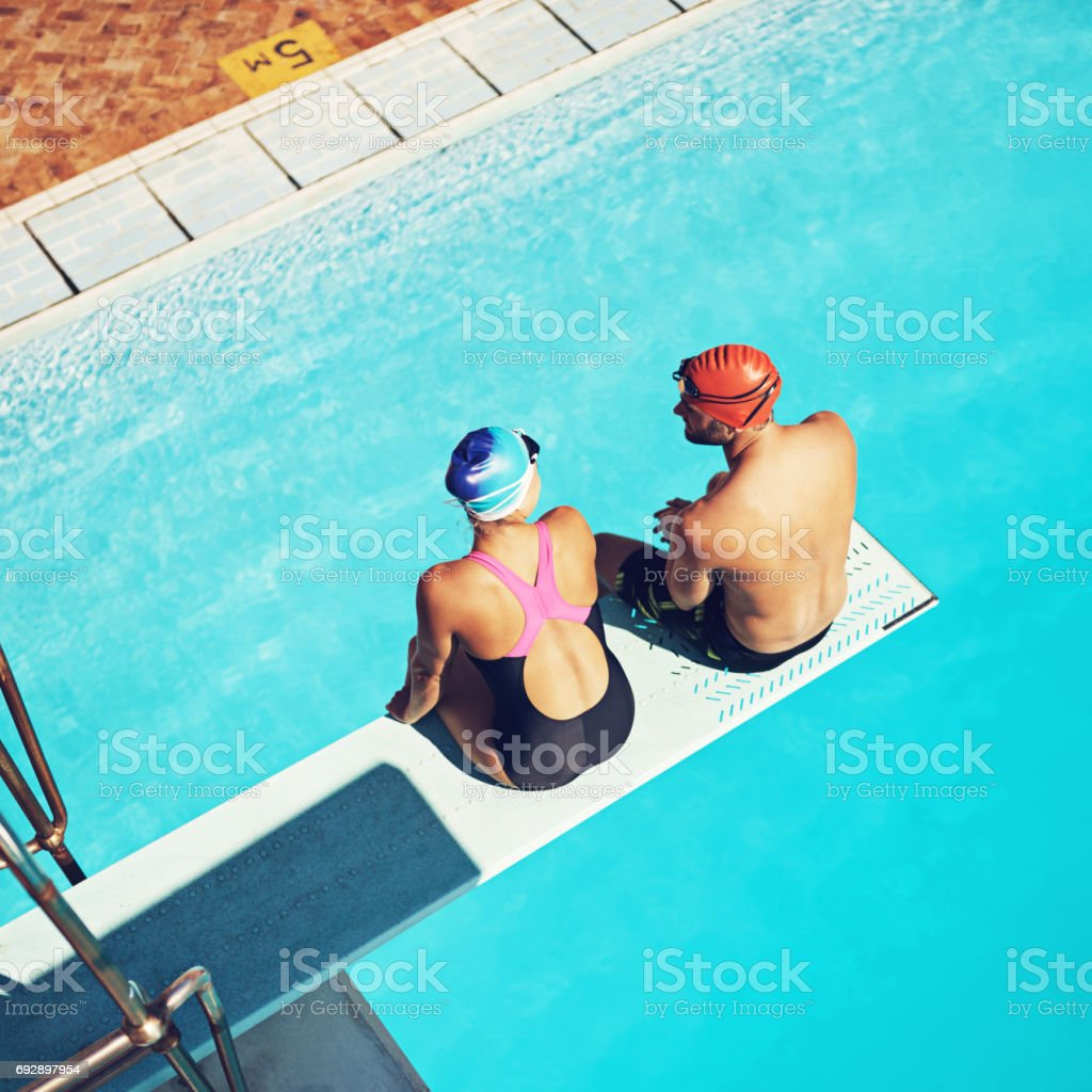 Swimming brought them together stock photo
