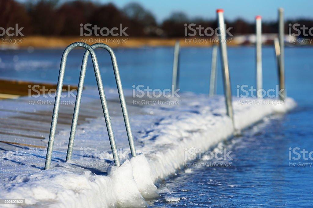 Swimming dock in winter stock photo