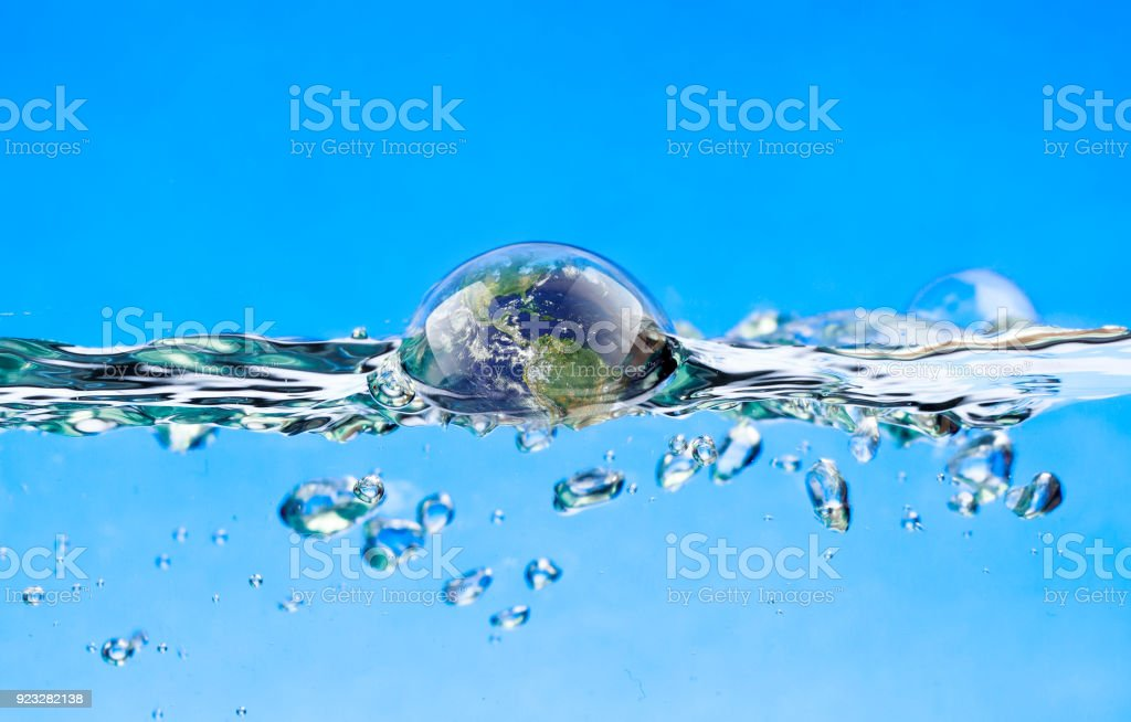 Swimming earth in the water Earth is immersed in water Abstract Stock Photo