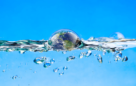 Swimming Earth In The Water Stock Photo - Download Image Now