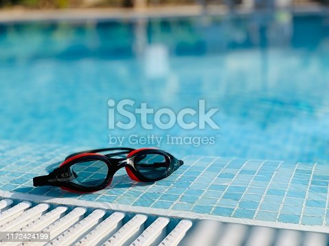 Swimming glasses near the swimming pool