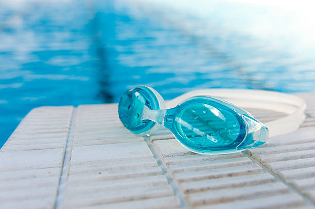 swimming goggles swimming goggles on starting block. swimming goggles stock pictures, royalty-free photos & images
