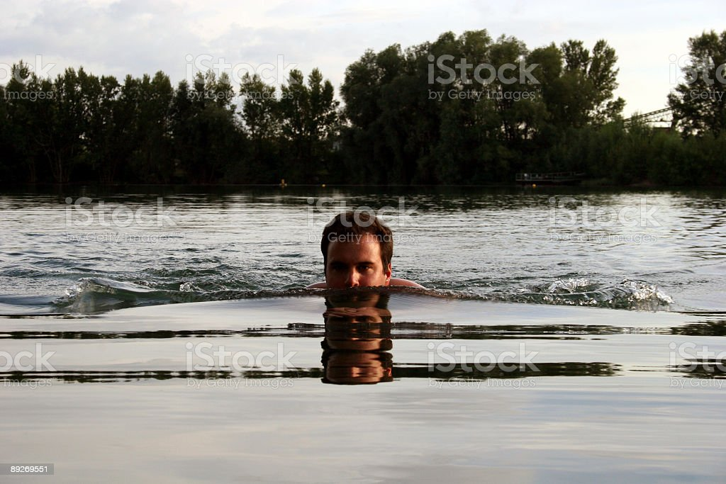 Swimming in a lake - Schwimmer im See stock photo