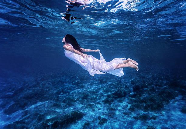 Swimming in beautiful blue sea stock photo