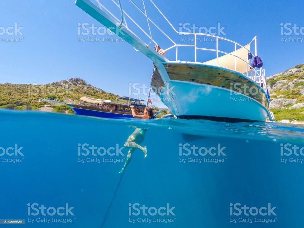 Temiz suda yüzmek. Antalya Kekova yuvasından / Türkiye. stok fotoğrafı
