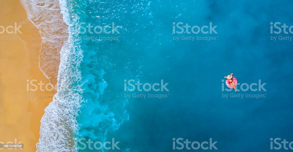 Swimming in clear turquoise sea at summer stock photo